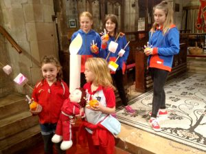 Claines Guides and Brownies taking part in a Christingle service