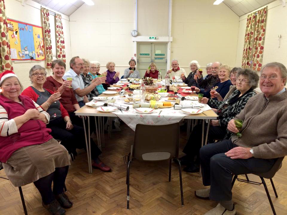 Claines church Quest group celebrating Christmas in the Village Institute