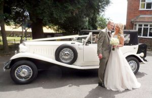 Vintage car and new weds at Claines Church